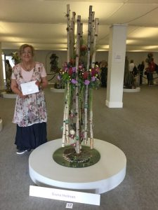 "Diana Holman with her exhibit  ""Beneath the Waves"" which won a silver medal at the Chelsea Flower Show for Dorset & Guernsey Area. Photo courtesy of Caroline Jackson, NAFAS Press Officer."